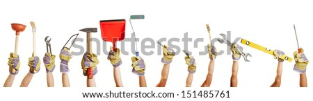 Many hands holding different tools for working and fixing things - stock photo
