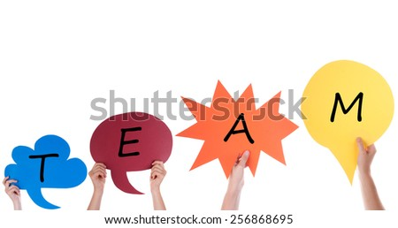 Many Hands Holding Four Colorful Speech Balloons Or Speech Bubbles With English Word Team Isolated On White - stock photo