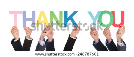 Many Hands Holding The Colorful Word Thank You Over White Background - stock photo
