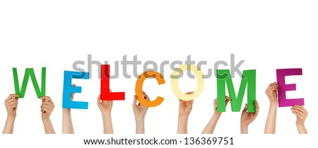 many hands holding the letters building WELCOME, isolated - stock photo