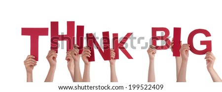 Many Hands Holding the Word Think Big, Isolated - stock photo