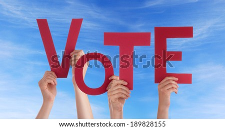Many Hands Holding the Word Vote in the Sky - stock photo