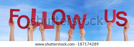 Many Hands Holding the Words Follow Us in the Sky - stock photo