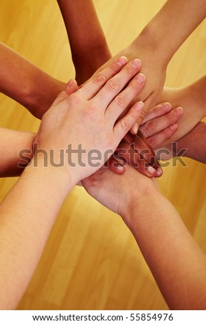 Many hands lying on top of each other - stock photo