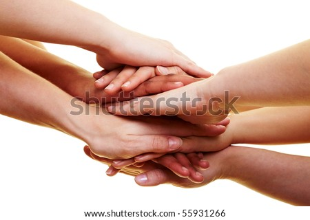 Many hands lying on top of each other