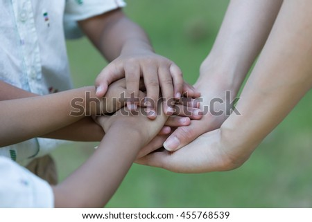 many hands make light work - stock photo