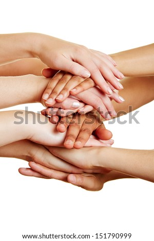 Many hands on a pile as concept for help and support - stock photo