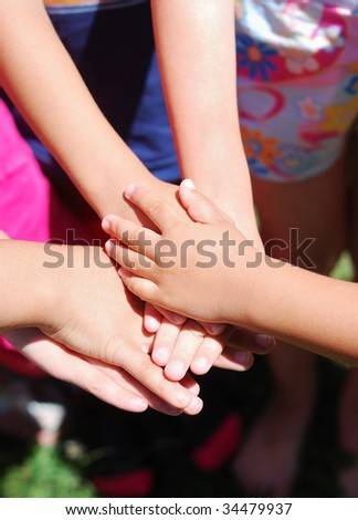 Many hands one on the other together - stock photo