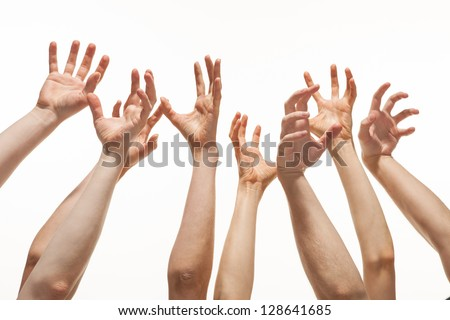 Many hands reaching out up in the air - stock photo