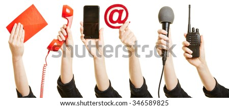 Many hands showing different ways of communication like mail, phone or internet - stock photo