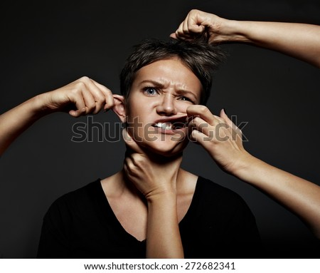 many hands touching women's face - stock photo