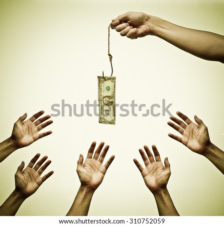 Many hands trying to get a dollar banknote hung on a fish hook - stock photo