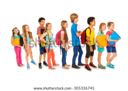 Many happy kids in a line to school - stock photo