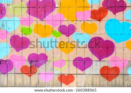 Many Hearts. Graffiti on the wall with many different coloured heart shapes. close up