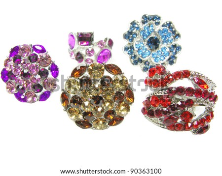 many jewelry ring with crystals isolated on white background - stock photo