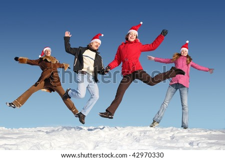 Many jumping people on snow