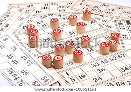 Many kegs and cards for bingo - stock photo