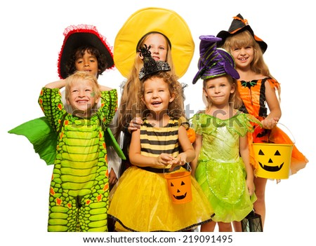 Many kids in Halloween costumes, boys and girls - stock photo