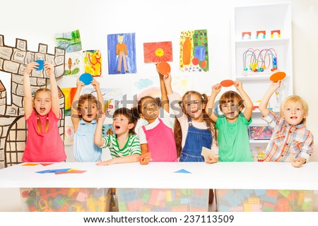 Many kids in the kindergarten class - stock photo