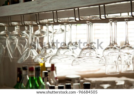 many kind of glasses on the bar closeup - stock photo