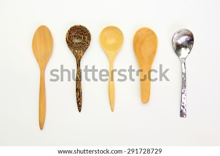 Many kind spoon on white background - stock photo