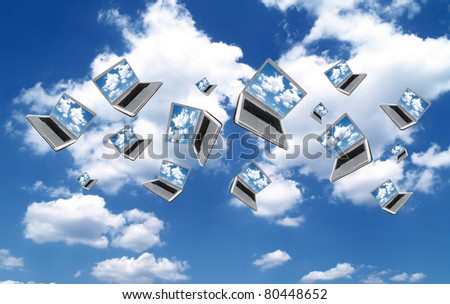 Many Laptops are flying with clouds - stock photo