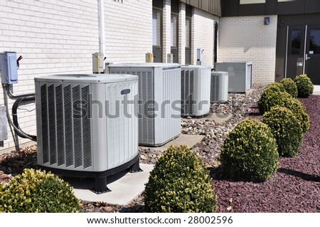 many large industrial size air conditioner units - stock photo