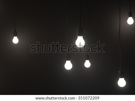 Many Light Bulbs Hanging with Plain Simple Background - stock photo