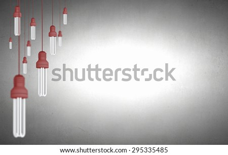 Many light bulbs on color background hanging from above