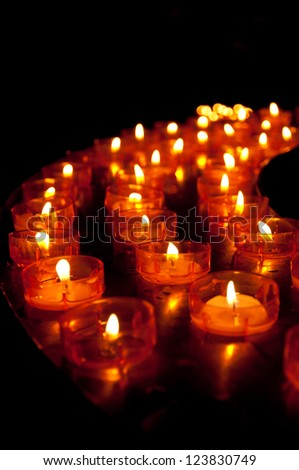 Many little candles in a half circle - stock photo