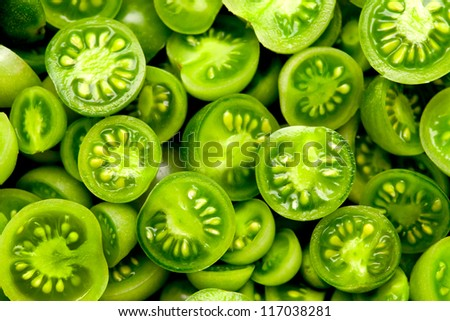 many little green cocktail tomatoes cut in half - stock photo
