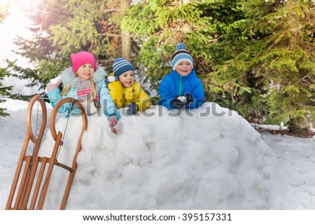 Many little kids play snowball in winter park - stock photo