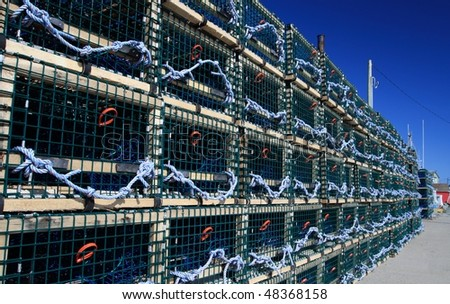 Many lobster traps on the pier - stock photo