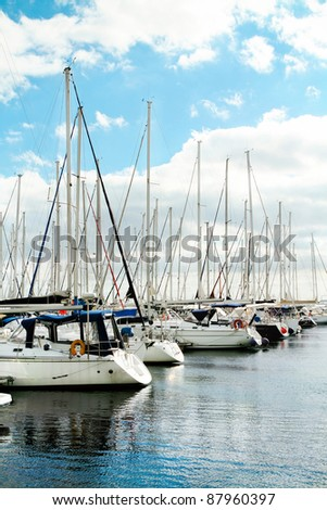 Many luxury yachts parked in a bay on the sea - stock photo