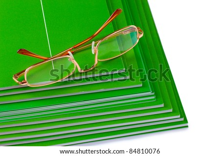 many magazines and glasses isolated on white - stock photo
