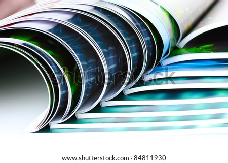 many magazines isolated on white - stock photo