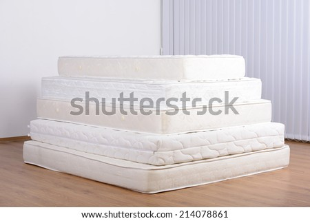 Many mattress in a pyramid in the room - stock photo
