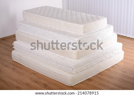 pile of mattresses. many mattress in a pyramid the room pile of mattresses