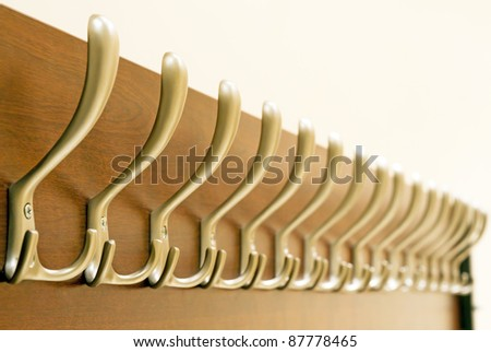 Many metal hanger over wood / Hangers / focus on the second hanger - stock photo