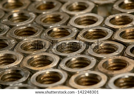 Many metal nuts - stock photo