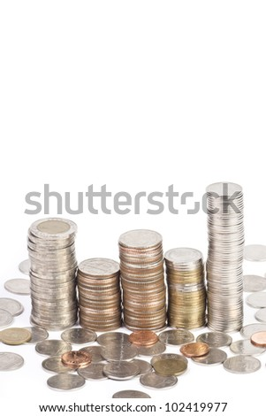 Many money coins stacked up isolated on a white background