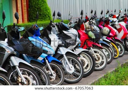 Many motobikes on the parking, Thailand - stock photo