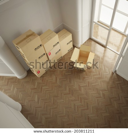 Many moving boxes from above in empty white room - stock photo