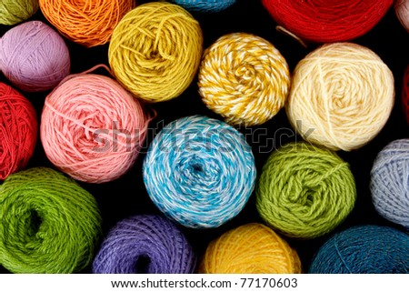 many multicolored clews, view from above, isolated on black - stock photo