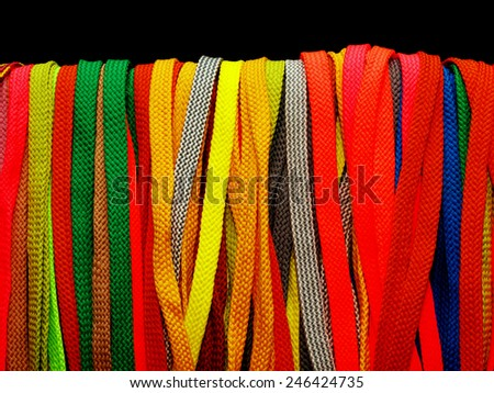 many multicolored shoelaces for shoes and sneakers - stock photo
