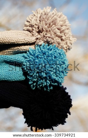 Many multicolored woolen knit hats - stock photo