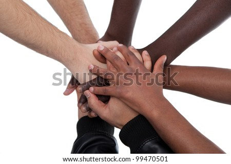 Many multiracial hands coming together as a team! - stock photo