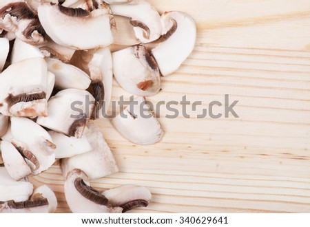 Many mushrooms on wooden table. Top view .