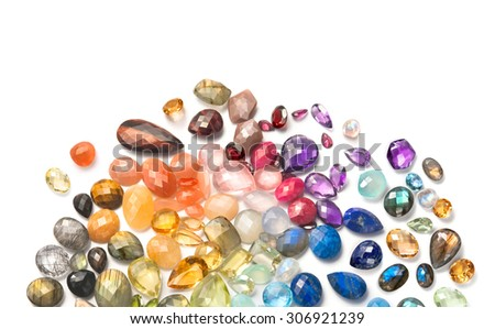 Many natural gemstones on the white background. Combination of different colors and shapes in real gems. - stock photo