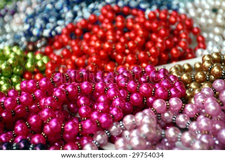 many necklaces from fake pearl - stock photo